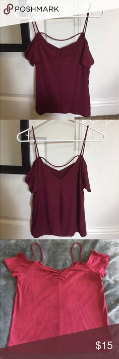 American Eagle cold-shoulder top 🌹 NEW WITHOUT TAGS: Maroon ribbed cold-shoulder top--stretchy and soft material. ❗️NOTE: the sizing for this top is a little odd so let me explain: it says XL, but it all depends on how you want it to fit. I'm normally a small and it's a little roomy on me, so if you want it to be a comfortable but form-fitting fit, I'd say medium or large! Please let me know if you have any questions :) American Eagle Outfitters Tops Tees - Short Sleeve