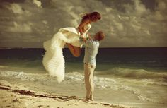 I don't think I'm getting married on the beach, this is just such a pretty picture!!