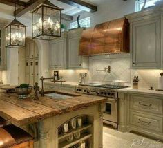 Love the counter tops,  island  wood and copper top