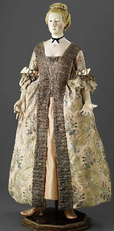 An Exceptionally Rare French 18th-Century Painted Wood Female Mannequin wearing a Robe à la française in silk metallic wrapped thread, Circa 1765. This exceptional object appears to be the only recorded surviving life-size 18th-Century French mannequin de mode. A remarkably similar figure appears in an engraving entitled 'La Couture ou Belle Promesse est de peu d'effet' published 1784 in Les Belles Marchandes, Almanach historique, proverbial et chantant (reproduced in Delpierre, fig.51…