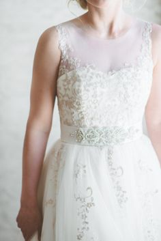 Belted wedding dress: http://www.stylemepretty.com/2013/08/14/minnesota-winter-wedding-from-paper-antler-photography/   Photography: Paper Antler Photography - http://paperantler.com/