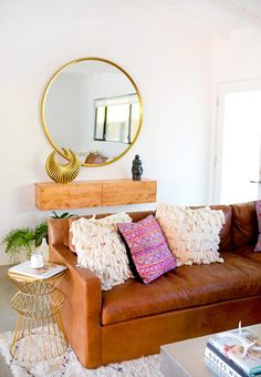 Textural styling on brown leather sofa