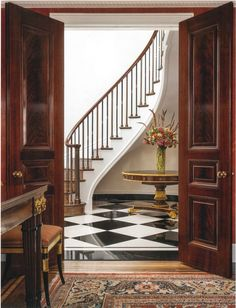 Beautiful egg and dart moldings, richly grained doors and the elegant simplicity of the balusters create architectural details that are soph...