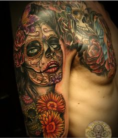 Getting my leg done  like this in a couple weeks. But not the same. Just the idea.  Of day of dead.