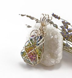 Rainbow bismuth crystal necklace  Silver wire by FeathersnThingz