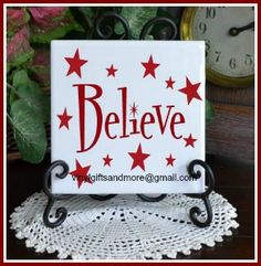 Believe with Stars - Vinyl Only - this comes in four sizes - 6 inch tile 8 inch glass block with an inside measurement of inch board and 12 inch tile Sample is shown on a 6 inch white tile in Dark Red vinyl. Cricut Christmas Ideas, Christmas Crafts To Make, Christmas Vinyl, Christmas Projects, Christmas Decorations, Vinyl Crafts, Vinyl Projects, Craft Projects, Coaster Crafts