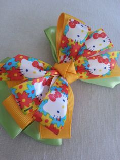 Hello Kitty Stacked Pinwheel Bow by Knotjuststring on Etsy, $10.00