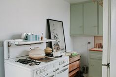 Claire Cottrell's Serene Home - LOVe that color on the cabinets
