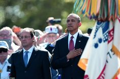 US President Barack Obama (R) and French President Francois Hollande (L) stand during a joint French-US D-Day commemoration ceremony at the Normandy American Cemetery and Memorial in Colleville-sur-mer @MailOnline Pics Pics on Twitter | DailyMail on Facebook