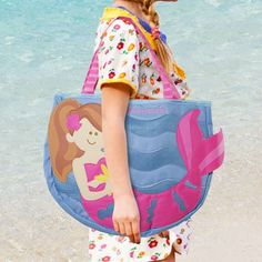 Mermaid Beach Tote that conveniently holds two shovels and three beach-themed molds. A mesh backing allows for sand or water to escape. Measures approximately 15?ǥ x 13?ǥ not including the handle.