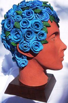 Cabeça em terracota e pintura policromada - Omar e as rosas