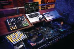DJ studio setup - love the custom slanted shelving