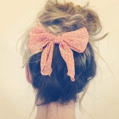 Hair bow with a high bun...