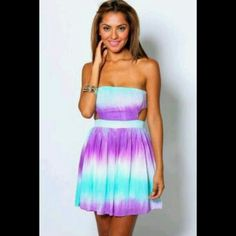 Sale! NWOT Gorgeous Tie Dye cutout festival dress Gorgeous Tie Dye cutout festival dress. Cutout sides with tie back w.zipper at skirt.  100% rayon, very soft. Fits size 4-8. Message me with any questions.  Xo Dresses Mini