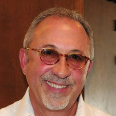 Emilio Estefan, Jr. (born March 4, 1953) is a Cuban-American 19-time Grammy Award winning musician and producer. Estefan's first taste of celebrity came as a member of the Miami Sound Machine. He is the husband of singer Gloria Estefan