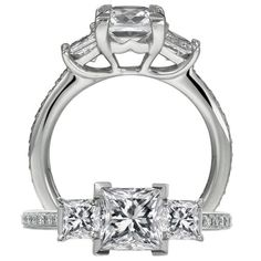 I had this engagement ring once upon a time... :)  Classic collection three stone ring with a princess cut center stone, princess cut side stones and round pave diamonds on the shank.