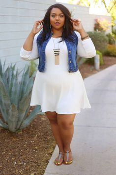 fd0eaef8b97 Curvy style inspiration  Layer a denim vest over a feminine fit   flare  dress for