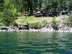 Lake Pend Oreille Waterfront Home Lake Pend Oreille, Cape Horn, 200' frontage, main home: 3 bed, 1.75 bath, 2272 sq ft, guest home: 1 bed, 0.75 bath, 352 sq ft, 4 total parcels for 0.872 acre, 2 car attached garage plus plenty of parking, lawn and garden areas, multiple decks, jetted tub in master bedroom, stunning views, covered deck on the water, large dock, breakwater, boat slip, shallow swimming area.