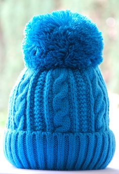 Stay warm and cozy with these large cute Pom Pom Hat. - Covers your ears comfortably and has folded cuff. Fleece lining inside. 20% wool - 80% acrylic Made in Ukraine One size fits most. Dimensions ar