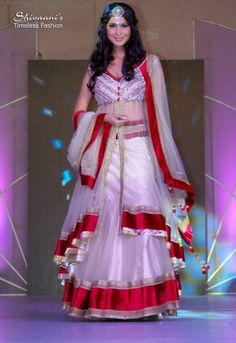Miss India Prachi Mishra walks the ramp in a dress designed and created by Shivaani...