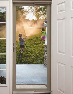 Because the best view is the view of your kids playing! A fullview Larson Storm Door makes this the view you can have every day!  #WelcomeHome #MyLarsonDoor #EnjoyTheView