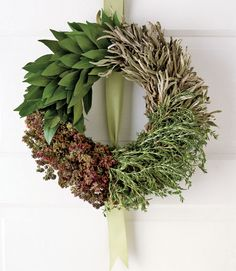 Bay Leaves, Rosemary, Sage, Oregano combined to create this stunning wreath. #wreaths #herbalwreath
