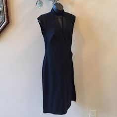 VINTAGE Diane Von Furstenberg Faux Wrap tux dress Beautiful like new faux wrap tuxedo dress by DVF. you can't beat the simplicity and beauty of this dress.   Item Location Bin D3 Diane von Furstenberg Dresses