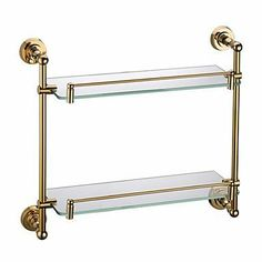 Contemporary Ti-PVD Bathroom Accessories Double Glass Shelf by Arctic. $149.99. Function: Glass Shelf  Style: Contemporary  Finish: Ti-PVD  color: Golden  Material: Brass  Mount: Wall Mounted  Dimension: 55*13*6  Glass Shelf Dimension: 62.5*13*5.5  Glass Shelf Shape: Rectangle  Glass Shelf Level: Double  Net Weight (kg): 1.2  Shipping Weight (kg): 1.45