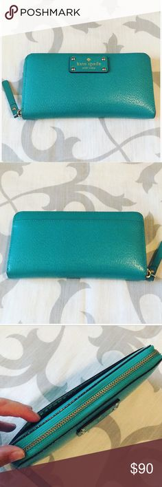 Kate Spade Neda Wellesley leather zip wallet! Color: turquoise blue. Only used a few times!! In great condition! Hardly any wear marks! Took a pic above of a tiny tiny scratch mark on the side of the wallet but you can barely even see it but I wanted to point it out just in case! Such an amazing wallet! So many compliments! Can't be bundled! kate spade Bags Wallets