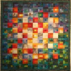 baby quilt a colourful quilt with photos in it.