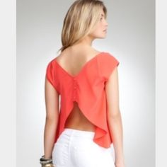 Beautiful Coral Bebe Top! Open Back Detail! This gorgeous top is in amazing condition! Gold buttons in the back! The top is open on the lower back. Would look amazing with any outfit year round! bebe Tops