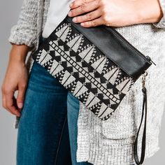 """Our tatreez wristlets are perfect for carrying the essentials! Each bag is hand-embroidered with by refugee and low-income women artisans with a traditional Palestinian tatreez design, the """" Cypress Tree"""" motif and crafted with locally sourced leather in Al Khalil (Hebron). Trade Federation, Tapestry Crochet Patterns, Ethical Fashion Brands, Embroidered Bag, Cross Stitch Patterns, Embroidery, Bridal Dresses, Stitches, Essentials"""
