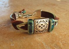 Twisted Leather bracelet with porcelain by WorldOfSquirrelCraft
