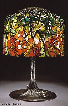 Louis Comfort Tiffany c1910. Dichroic trumpet creeper leaded glass and bronze table lamp.