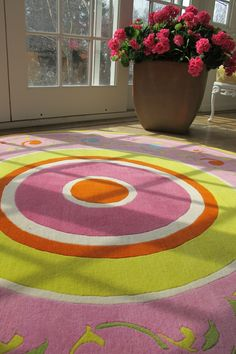 beautiful colorful circle rug! hot pink, lime green, orange, light pink, acid green,and bright blue designs! LoLo Moore Design Custom Rugs