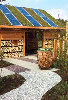 a very cute combination of solar panel and green roof - looks suburban acceptable :)