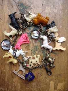Vintage Dogs Charm Bracelet with Pink RCA Dog  ...This one has 19 different, vintage, dog charms including celluloid, metal, glass cabochons. All the charms are vintage and special and many breeds are represented including: Scottish Terriers, Boxers, Bulldogs, Dachshunds, mutts and more! One is the old RCA dog in bright pink!...