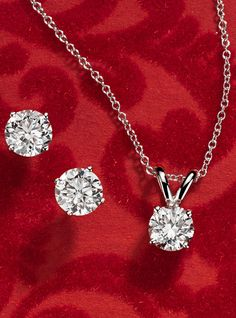 Give the gift of sparkle - A solitaire diamond pendant, featuring in 14k white gold or these beautifully matched diamond stud earrings .