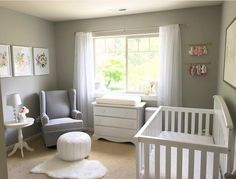 Gray and white nursery. Floral nursery.