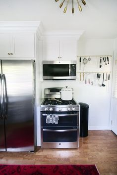 She decided to switch the order and also placed the microwave above the oven.
