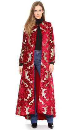 A shimmering, extra-long alice + olivia coat. The dramatic, flared silhouette is cut from metallic brocade and finished with a flocked velour pattern. Hook-and-eye closures fasten the placket, and pockets hide at the sides. Long sleeves. Lined.Fabric: Metallic, flocked brocade.Shell: 80% rayon/20% polyester.Lining: 95% polyester/5% spandex.Dry clean.Imported, China.MeasurementsLength: 52in / 132cm, from front shoulderMeasurements from size S
