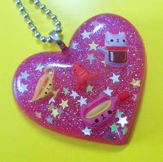 Resin Heart necklace - Cat Snacks Heart. $22.00, via Etsy.