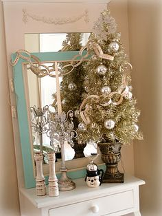 I like the paper chain, and the empty frame over the mirror