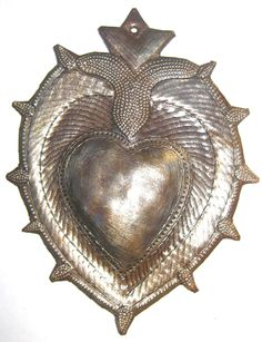 Haitian, Sacred Heart made from oil drums, weather coating allows them to be displayed outside 3 X 4 inches