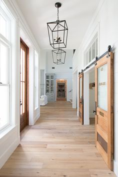 magnolia homes joanna gaines Aude Smith Architecture. Chip and Joanna Gaines, Magnolia Homes. Buffalo Lumber Company Inc. Light Wood Floors, House Design, Farm House Living Room, House, Magnolia Homes, Home, Farmhouse Light Fixtures, Joanna Gaines Light Fixtures, Barn Doors Sliding