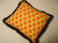 yellow with pink flower bursts, black microfiber super soft back, comfortable pillow for any home!