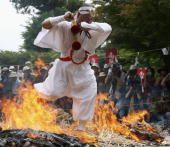 A monk prays during the annual Fire Festival held at the Konjoin Temple on June 28, 2006 in Nasushiobara, Tochigi Prefecture, Japan. Every year around 1000 visitors come to participate and to wish for good luck at the 1200 year old Temple. (Photo by Koichi Kamoshida/Getty Images)