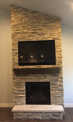 Floor To Ceiling Alderwood Stacked Stone Fireplace Face With Limestone Hearth Tv Above Box Mantel