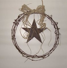 Barbed Wire Wreath with Barn board Star.