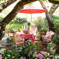 Include a large market umbrella in your patio decor. Besides providing much-needed shade to an unprotected patio, it adds a nice vertical element to the usual horizontal lines of an outdoor room as well as bringing in color  overhead.